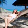 Woman relaxing in hammock — Stock Photo