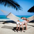 Romantic couple relaxing in hammock - Stock Photo