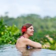 Woman relaxing at swimming pool — Stock Photo