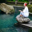 Beautiful woman meditating - Stock Photo
