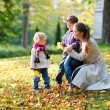 Family at autumn park - Stock Photo