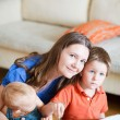Stock Photo: Mother and kids at home