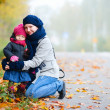 Royalty-Free Stock Photo: Mother and daughter outdoors on foggy day