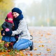 Mother and daughter outdoors on foggy day — Stock Photo #4093567