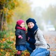 Mother and daughter outdoors on foggy day — Stock Photo