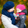 Mother and daughter at autumn park — Stock fotografie