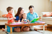 Family of four at home — Stock Photo