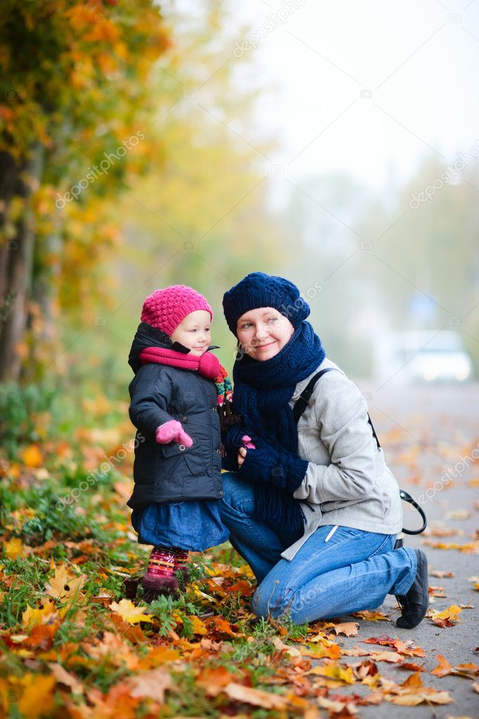 Mother and daughter outdoors on beautiful foggy day  Stock Photo #4093571