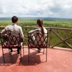 Couple on balcony of safari lodge — Stock Photo #4144190
