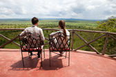 Couple on balcony of safari lodge — Stock Photo