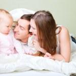 Family in bedroom — Stock Photo #4161004
