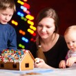 Royalty-Free Stock Photo: Family making gingerbread house