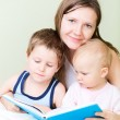 Family reading in bed — Stock Photo #4166390