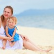 Mother and daughter at tropical beach — Stock Photo #4166598