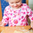Little girl baking cookies — Stock Photo