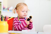 Toddler girl playing with finger puppets — Stock Photo