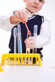 Boy practicing chemistry — Stock Photo