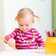 Toddler girl drawing with pencils — Stock Photo #4231082