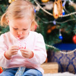 Toddler girl with Christmas candy — Stock Photo #4299623