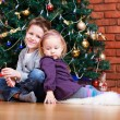 Two kids at Christmas - Stock Photo
