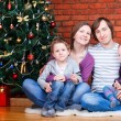 Family near Christmas tree — Stockfoto #4299783