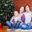 图库照片: Family near Christmas tree