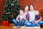 Family near Christmas tree — 图库照片