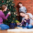 Family decorating Christmas tree — Stock Photo #4358132