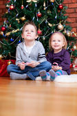 Brother and sister near Christmas tree — Foto de Stock