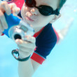Little boy swimming underwater - ストック写真