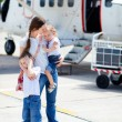 Royalty-Free Stock Photo: Mother and kids in front of airplane