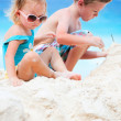 Two adorable kids playing together at beach — Foto de Stock