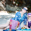 Mother and daughter on beach — Stock Photo #4680328