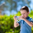 Stock Photo: Boy with camera
