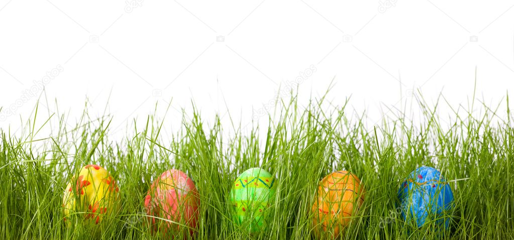 Row of five Easter eggs in fresh green grass — Stock Photo #4687358