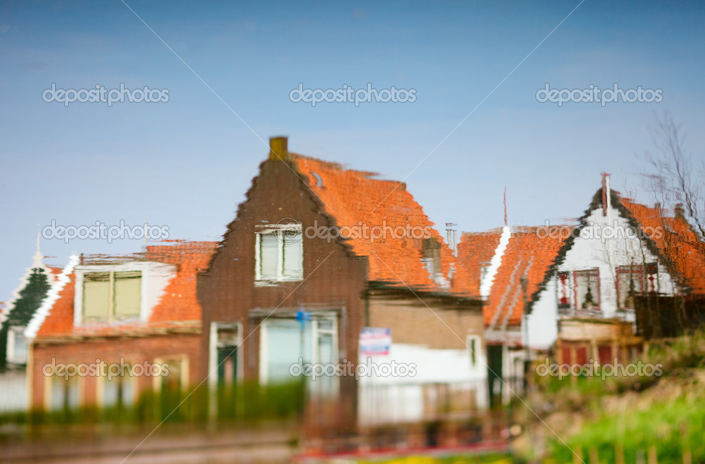 Dutch Countryside reflection in water. Taken in village of Volendam, The Netherlands.  Stock Photo #4693830