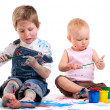 Boy and girl painting — Stock Photo