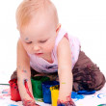 Toddler girl painting — Stock Photo