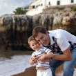 Royalty-Free Stock Photo: Happy father and son having fun outdoors