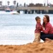 Mother and son playing together outdoors — Stock Photo