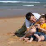 Family fun at the beach — Stock Photo #4729658