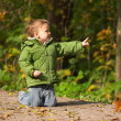 Stock Photo: Little boy and squirrel
