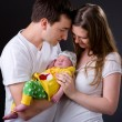 Happy young parents and newborn girl — Stock Photo #4729768