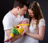 Happy young parents and newborn girl — Stock Photo