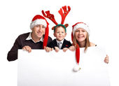 Christmas family with banner — Stock Photo