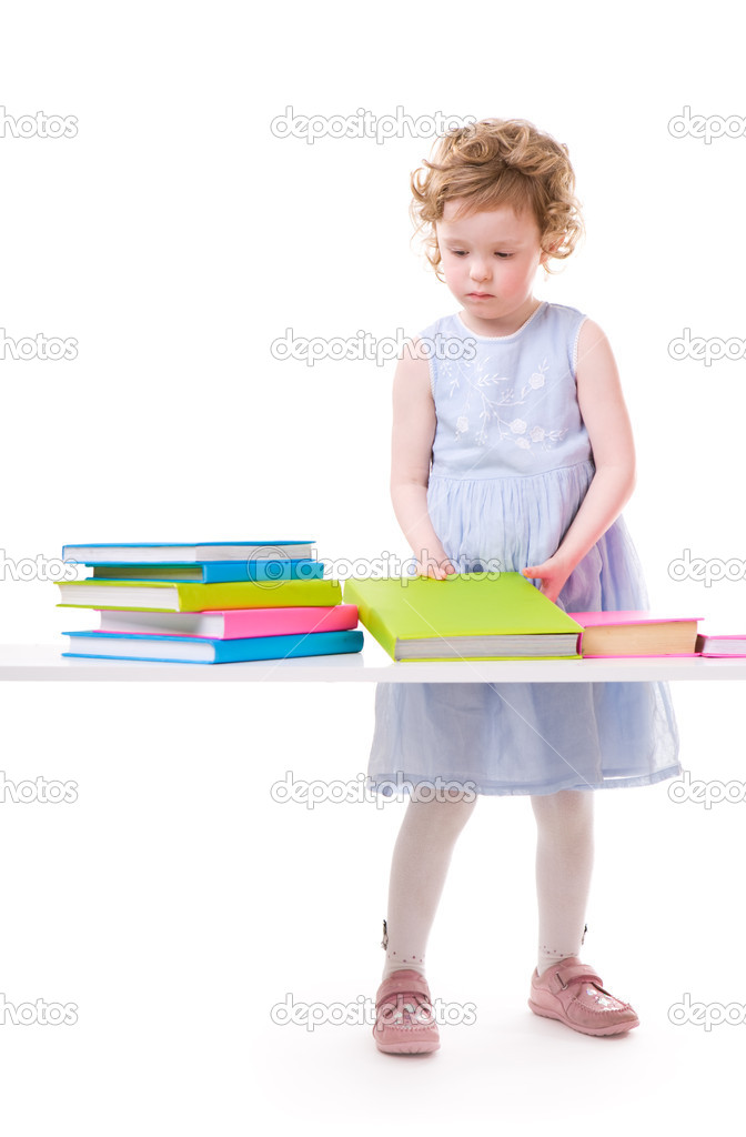 Back To School. Little girl with books isolated on white background  Stock Photo #4729480