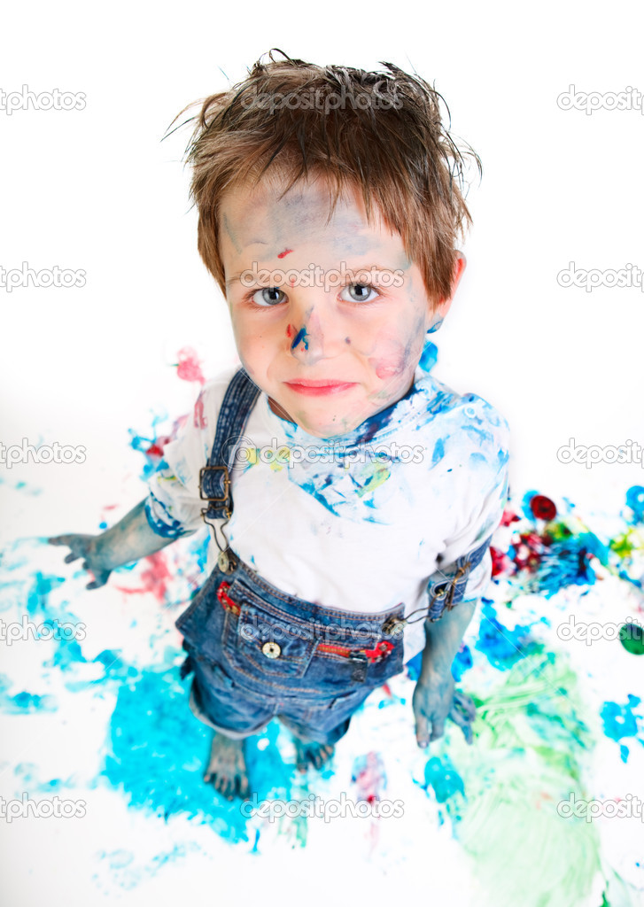 Funny photo of cute 5 years old boy painting on white background — Stock Photo #4729598