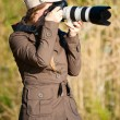 Female photographer - Stockfoto