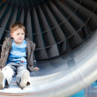 Boy inside turbine - Stock Photo