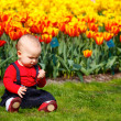 Baby girl in garden — Stock Photo